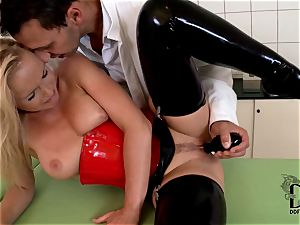 harsh towheaded in latex dildoed by the physician