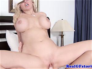 ginormous boobed platinum-blonde housewife enjoying salami