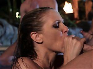 Julia Ann deep throats a gang of shafts in a pool
