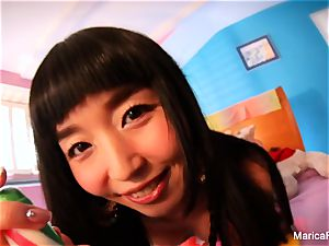 asian star Marica Hase plays with candy manmeat