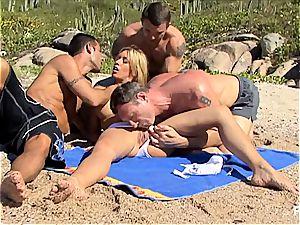 ultra-kinky Lea tearing up 3 guys on the beach
