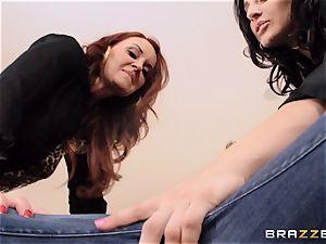 Gracie Glam and Janet Mason grasp a weirdo
