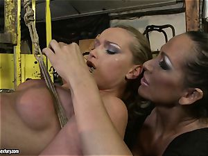 Kathia Nobili and Mandy Bright figure roping with strap